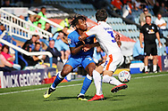 Peterborough United forward Ivan Toney (17) tussles with Luton Town defender Dan Potts (3) during the EFL Sky Bet League 1 match between Peterborough United and Luton Town at London Road, Peterborough, England on 18 August 2018.