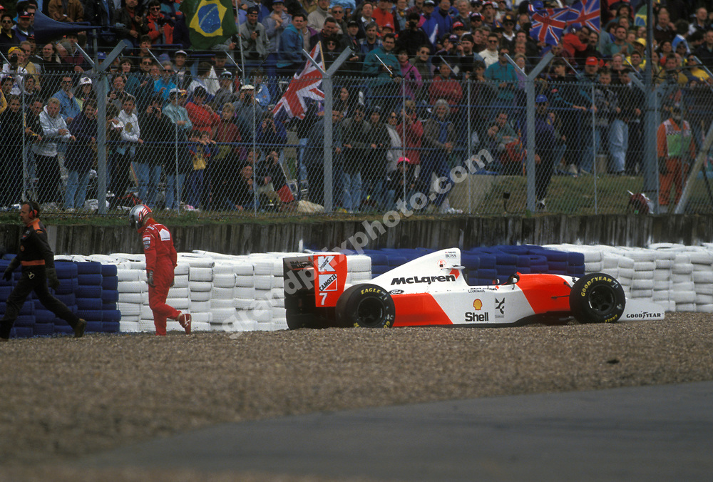 Michael Andetti walks away after crashing his McLaren-Ford in the 1993 British Grand Prix in Silverstone. Photo: Grand Prix Photo
