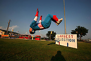 Daryn Alves, 17, performs flips by the road to draw customers into family-owned Colby's Fireworks at County Road 746 and Highway 205 in Nevada, Texas, Thursday July 2, 2009.  Alves is a friend of Colby Matzke, whose family owns 3 fireworks stands in Collin County.