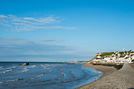 The beach in Arromanches, Normandy, France. In the days after D-Day the Allies built a large artificial port here called Mulberry Harbour, the remains of which are still visible in the water.