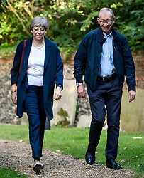 © Licensed to London News Pictures. 02/07/2017. Maidenhead, UK. British prime minister THERESA MAY and her husband PHILIP wearing colourful sports watches at they arrive to attend church her constituency in Maidenhead, Berkshire, UK . Photo credit: Ben Cawthra/LNP