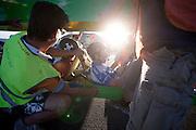 Tom Amick en Phil Plath worden uit hun Glow Worm gehaald na hun wereldrecord tandem op de vierde racedag van de WHPSC. In de buurt van Battle Mountain, Nevada, strijden van 10 tot en met 15 september 2012 verschillende teams om het wereldrecord fietsen tijdens de World Human Powered Speed Challenge. Het huidige record is 133 km/h.<br /> <br /> Tom Amick and Phil Plath at the finish after setting an new world record on the fourth day of the WHPSC. Near Battle Mountain, Nevada, several teams are trying to set a new world record cycling at the World Human Powered Vehicle Speed Challenge from Sept. 10th till Sept. 15th. The current record is 133 km/h.