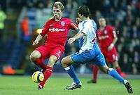 Fotball<br /> Premier League England 2004/2005<br /> 21.11.2004<br /> Foto: SBI/Digitalsport<br /> NORWAY ONLY<br /> <br /> Blackburn v Birmingham<br /> Barclays Premiership. 21/11/2004. <br /> <br /> Jesper Grønkjær of Birmingham City is challenged by Lucal Neill of Blackburn Rovers