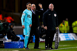 Miguel Almiron of Newcastle United stands with Newcastle United manager Rafa Benitez as he prepares to make his debut - Mandatory by-line: Robbie Stephenson/JMP - 11/02/2019 - FOOTBALL - Molineux - Wolverhampton, England - Wolverhampton Wanderers v Newcastle United - Premier League