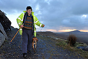 Owner David O'Connor reunited with his beagle hound Shandon at Fogher Cliffs on Valentia Island after the dog was rescued by the coastguard having spent three days trapped on the cliffs on Monday.<br /> Picture by Don MacMonagle