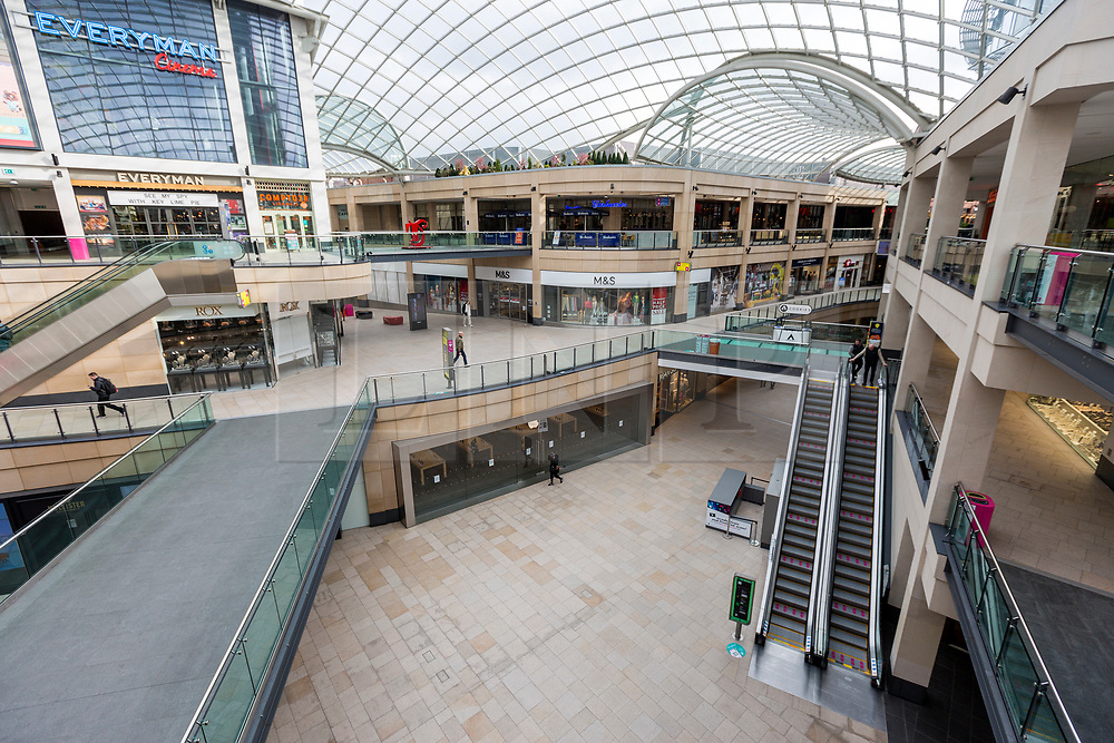 © Licensed to London News Pictures. 17/03/2020. Leeds UK. Trinity shopping centre in Leeds city centre almost empty this morning after yesterdays announcement that people should work from home & everyone should avoid pubs, clubs & restaurants. Photo credit: Andrew McCaren/LNP