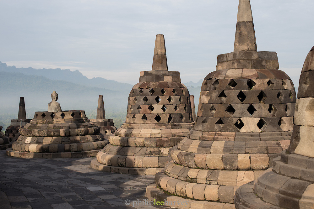 Stupas and Statue of Buddha, Borobudur, Kedu Valley, South Central Java, Java, Indonesia, Southeast Asia