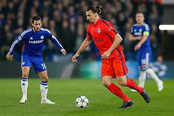 Zlatan Ibrahimovic of Paris Saint-Germain is challenged by Eden Hazard of Chelsea - Photo mandatory by-line: Rogan Thomson/JMP - 07966 386802 - 11/03/2015 - SPORT - FOOTBALL - London, England - Stamford Bridge - Chelsea v Paris Saint-Germain - UEFA Champions League Round of 16 Second Leg.