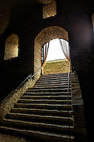 View from the bottom of a stone staircase inside the ruins of Rheinfels Castle, St. Goar, Germany.