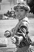A young girl dances the hula.