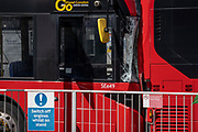 The aftermath of a collision of two buses, in which a young woman in her thirties was killed and two others were injured, at Victoria Station, on 10th August 2021, in London, England.