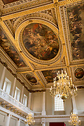 The painting by Paul Rubens on the ceiling of Banqueting House, on 17th September 2017, in Whitehall, Westminster, London, England. The ceiling of the Banqueting House is a masterpiece and the only surviving in-situ ceiling painting by Flemish artist, Sir Peter Paul Rubens. It is also one of the most famous works from the golden age of painting. The canvases were painted by Rubens and installed in the hall in 1636. The three main canvasses depict The Union of the Crowns, The Apotheosis of James I and The Peaceful Reign of James I. Most likely commissioned by King Charles I in 1629-30, this ceiling was one of his last sights before he was executed on a scaffold outside on Whitehall in 1649.