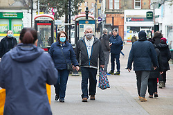 © Licensed to London News Pictures 16/02/2021.        Dartford, UK. People out and about in Dartford town centre in Kent today during a third national coronavirus lockdown. Non-essential shops could open in weeks if the Covid-19 infection rate keeps dropping. Photo credit:Grant Falvey/LNP