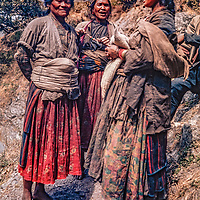 Village women chat along the trail in the Langtang Valley in the foothills of the Nepal Himalaya.