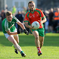 O'Curry's-Naomh Eoin's Niall Bonfil is chased by Kilrush Shamrock's Padraig Browne