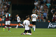 Fabrício Dornellas of Astra Giurgiu celebrates on his knees after Filipe Teixeira of Astra Giurgiu shoots to score his sides 1st goal to make it 0-1 on the night. UEFA Europa league, 1st play off round match, 2nd leg, West Ham Utd v Astra Giurgiu at the London Stadium, Queen Elizabeth Olympic Park in London on Thursday 25th August 2016.<br /> pic by John Patrick Fletcher, Andrew Orchard sports photography.