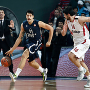 Anadolu Efes's Cenk Akyol (C) and Olympiacos's Konstantinos Papanikolaou (R) during their Turkish Airlines Euroleague Basketball Top 16 Group E Game 4 match Anadolu Efes between Olympiacos at Sinan Erdem Arena in Istanbul, Turkey, Wednesday, February 08, 2012. Photo by TURKPIX