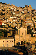 The town of Agira in northeast Sicily. Stone houses and churches cascade down the hill side.