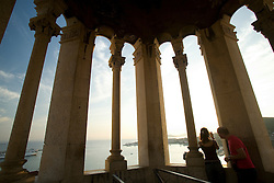 Europe, Croatia, Dalmatia, Split.  Tourists enjoy view of Adriatic Sea and Split from top of Campanile (belltower) of Cathedral of St. Domnius.
