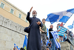 June 16, 2018 - Athens, Greece - Protesters wave Greek flags  during a protest against the agreement between Greece and Macedonia over the dispute of the former Yugoslav's republic name, outside the Greek Parliament, in Athens. Greek lawmakers on Saturday debated for a final day on a no-confidence motion against the government over a deal to end a decades-old dispute with neighboring Macedonia over the latter's name. (Credit Image: © Aristidis Vafeiadakis via ZUMA Wire)