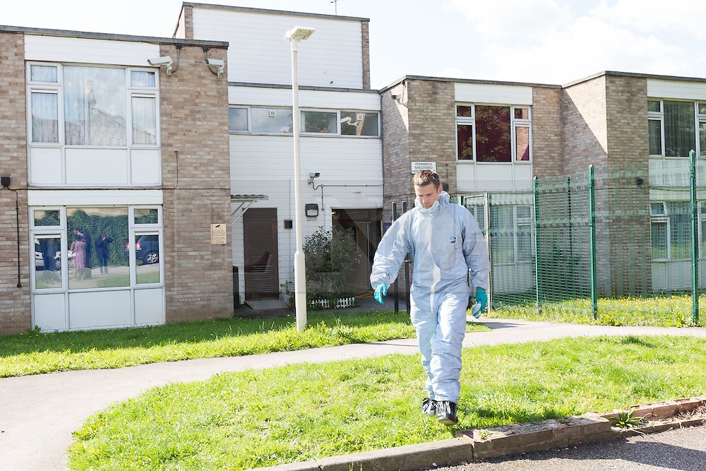 © Licensed to London News Pictures. 06/09/2015. London, UK. A forensic officer leaving Fernways sheltered housing unit in Fernways off Cecil Road in Ilford, Essex. Police attended the unit last night following reports of an assault. A woman aged in her mid-50's and a man in his mid-80's were pronounced dead at the scene last night, who suffered stabbing injuries. Photo credit : Vickie Flores/LNP
