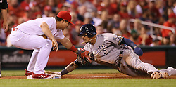 September 29, 2017 - St Louis, MO, USA - St. Louis Cardinals third baseman Aledmys Diaz, left, tags out the Milwaukee Brewers' Orlando Arcia trying to steal third in the sixth inning on Friday, Sept. 29, 2017, at Busch Stadium in St. Louis. The Brewers won, 5-3. (Credit Image: © Chris Lee/TNS via ZUMA Wire)