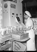 03/06/1954<br /> 06/03/1954<br /> 03 June 1954<br /> Kellogg's factory at Terenure, Dublin. Image shows boxes of Corn Flakes being filled on the packaging line in the factory.
