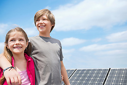 Brother sister portrait smiling solar energy