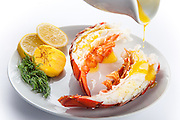 Lobster tails drizzled with butter. Photographed in studio using high key lighting