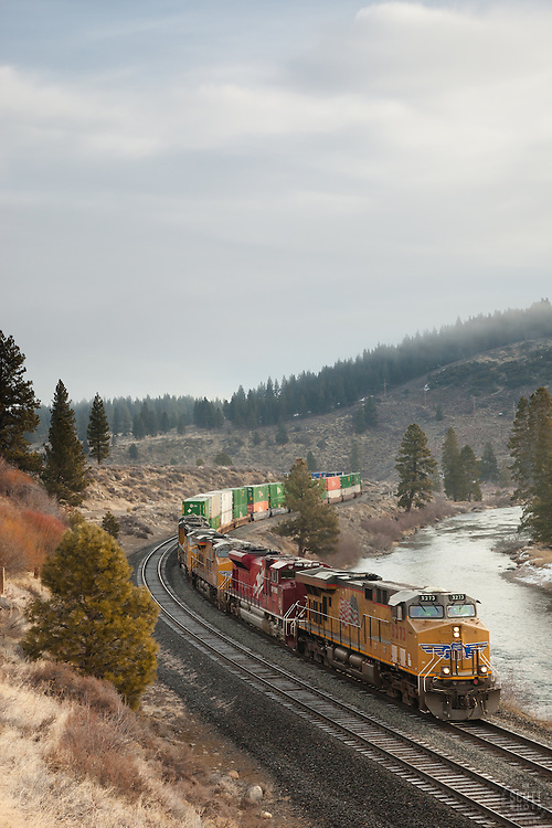 """""""Train along the Truckee River"""" - This moving train was photographed in the early morning along the Truckee River in Truckee, CA."""