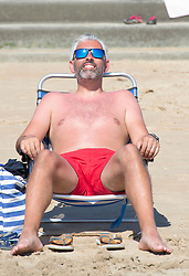 ©Licensed to London News Pictures 07/08/2020   Dymchurch, UK. Sunbathing on the beach. Dymchurch in Kent on the south coast. Scorching hot weather today in the UK as the heatwave weather looks set to continue into next week. Today could be one of the hottest on record if not the hottest. Photo credit: Grant Falvey/LNP