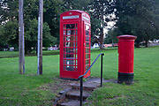 The phone kiosk and postal box still in service and good working order on the Green at Hartest, on 10th July 2020, in Hartest, Suffolk, England.