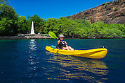 Kayaking on Kealakekua Bay(Captain Cook monument visible), Kona Coast, Hawaii USA
