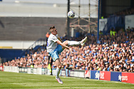Coventry City Midfielder, Jordan Shipley (26) tries to keep the ball in play during the EFL Sky Bet League 1 match between Portsmouth and Coventry City at Fratton Park, Portsmouth, England on 22 April 2019.