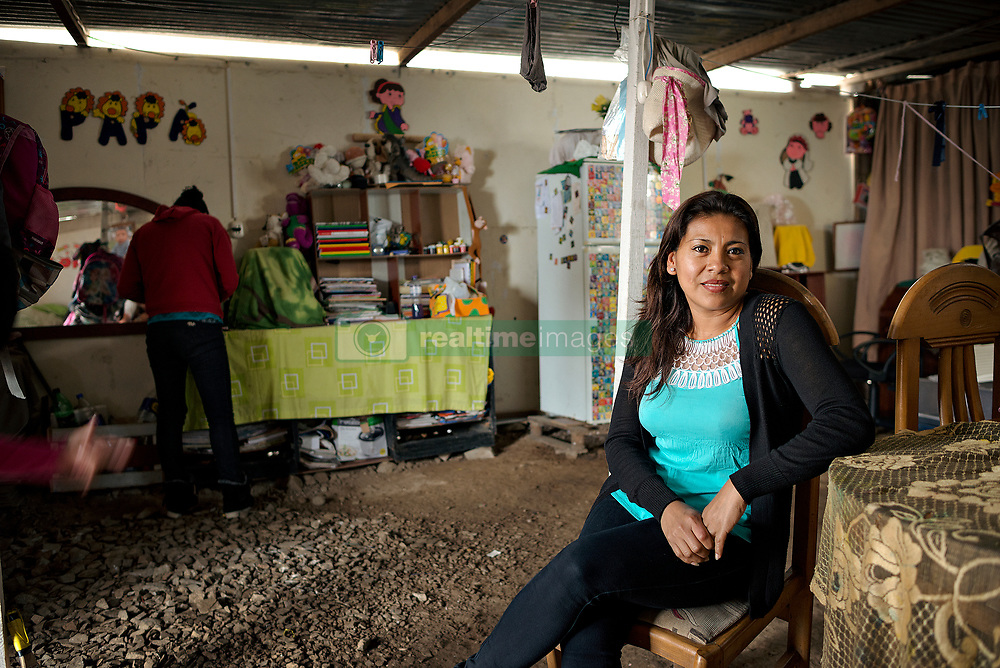 NO WEB/NO APPS - (Text available) Elisa, a 39-year-old professor feels 'marginalized by society. To go to work I must wake up at 5am. Be cause of the wall I need 2 hours to reach my workplace' she said, in Lima, Peru in May 2017. In Peru's capital Lima, a three-meter-high concrete wall topped with reels of razor wire separates two areas. The so-called 'Wall of Shame' - sometimes nicknamed 'Peru's Berlin Wall' - divides the urbanisation of Las Casuarinas, where some of the country's richest inhabitants live, and the poor suburb of Vista Hermosa next door. It was initially put up over fears that the inhabitants from the poor neighbourhood would steal from wealthy fellow citizens living nearby. On the rich side of the wall, the price for a square meter can exceed 2,000 dollars. To enter the area, you must show your ID to the guards watching the gate at the bottom of the hill. Former high-ranking politicians and bank directors live here. Their houses are surrounded by lush gardens and swimming pools despite the scarcity of water. Meanwhile, on the San Juan de Miraflores side, residents often fall victim to robbery and theft. They live in houses of barely 25m², made from scrap material, surrounded by the sand and earth characteristic of Lima's desert landscape. Photo by Giacomo D'Orlando/ABACAPRESS.COM