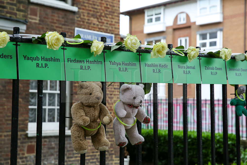 © Licensed to London News Pictures. 14/06/2019. London, UK. The names of people who lost their lives, hung from railings on a block of flats to commemorate the second anniversary of the Grenfell Tower fire service. On 14 June 2017, just before 1:00am a fire broke out in the kitchen of the fourth floor flat at the 24-storey residential tower block in North Kensington, West London, which took the lives of 72 people. More than 70 others were injured and 223 people escaped. Photo credit: Dinendra Haria/LNP