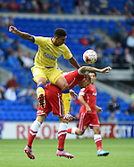 Sheff Wed's Liam Palmer challenges Aron Gunnarsson of Cardiff city. Skybet football league championship match, Cardiff city v Sheffield Wed at the Cardiff city stadium in Cardiff, South Wales on Saturday 27th Sept 2014<br /> pic by Andrew Orchard, Andrew Orchard sports photography.