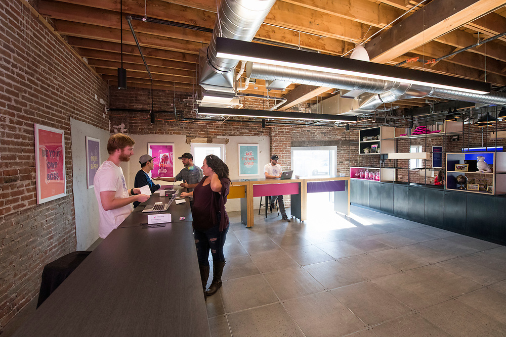 DENVER – NOV. 3.: The newly opened office of rideshare company Lyft is pictured inside STEAM on the Platte, a newly redeveloped historic reuse space at W. 14th Avenue and Zuni streets in Denver's Sun Valley neighborhood. Pictured at front left are Lyft employee Nathan LeCompte, 23, of Wash Park, as he speaks during an appointment with Lyft driver Melissa McGilvrey, 42, of Littleton. (Photo by Andy Colwell/Special to The Denver Post)