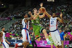 Zoran Dragic of Slovenia between Edgar Sosa and Orlando Sanchez of Dominican Republic during basketball match between National Teams of Slovenia and Dominican Republic in Eight-finals of FIBA Basketball World Cup Spain 2014, on September 6, 2014 in Palau Sant Jordi, Barcelona, Spain. Photo by Tom Luksys  / Sportida.com <br /> ONLY FOR Slovenia, France