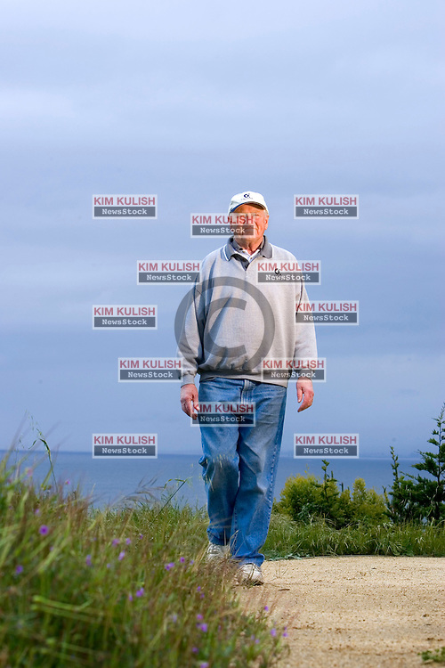 """Portrait of former Calpine CEO Peter Cartwright near his home with his son's dog """"Crockett"""" along the Pacific Ocean in La Selva Beach, Calif.."""