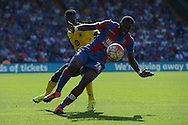 Bakary Sako of Crystal Palace tumbles while Micah Richards of Aston Villa challenges.  Barclays Premier league match, Crystal Palace v Aston Villa at Selhurst Park in London on Saturday 22nd August 2015.<br /> pic by John Patrick Fletcher, Andrew Orchard sports photography.