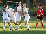 Beacon, New York - Beacon High School players, at left, celebrate after scoring a goal against Sleepy Hollow High School in a Section One Class A girls' soccer playoff game on Oct. 28, 2010. ©Tom Bushey / The Image Works