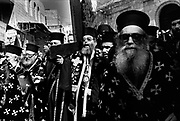 Greek Orthodox priests walk up the Via Dolorosa marking the Stations of the Cross during Holy Week Jerusalem Israel
