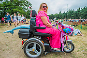 Shark tailed disability scooter wates for a performance on the Waterfront stage - The 2017 Latitude Festival, Henham Park. Suffolk 15 July 2017