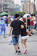 A young couple walk along the Bund Shanghai, China