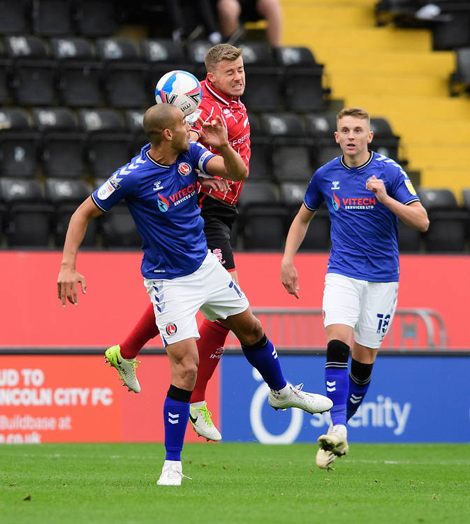 Lincoln City's James Jones vies for possession with Charlton Athletic's Darren Pratley<br /> <br /> Photographer Chris Vaughan/CameraSport<br /> <br /> The EFL Sky Bet League One - Lincoln City v Charlton Athletic - Sunday 27th September, 2020 - LNER Stadium - Lincoln<br /> <br /> World Copyright © 2020 CameraSport. All rights reserved. 43 Linden Ave. Countesthorpe. Leicester. England. LE8 5PG - Tel: +44 (0) 116 277 4147 - admin@camerasport.com - www.camerasport.com