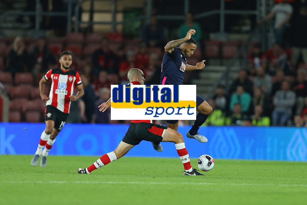Football - 2019 / 2020 Premier League - Southampton vs. AFC Bournemouth<br /> <br /> Bournemouth's Callum Wilson hurdles a challenge from Southampton's Oriol Romeu during the Premier League match at St Mary's Stadium Southampton <br /> <br /> COLORSPORT/SHAUN BOGGUST