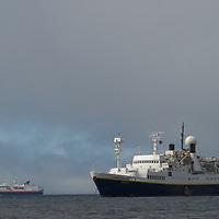 A huge cruise ship passes the smaller National Geographic Endeavor near New Island in Britain's Falkland Islands.