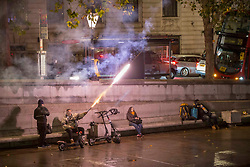 © Licensed to London News Pictures. 30/10/2020. London, UK. A man with fireworks during the pre-Halloween night out, many on electric scooters in Trafalgar Square, central London. Photo credit: Marcin Nowak/LNP