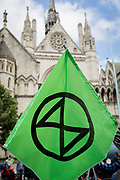 "Environmental and climate change protesters block Fleet Street outside the High Court on the first day of a week-long country-wide protests using using five boats to stop traffic in Cardiff, Glasgow, Bristol, Leeds, and London, on 15th July 2019, in London, England. The group is calling on the government to declare a climate emergency, saying it was beginning a five-day ""summer uprising"" and that 'Ecocide' ought to be a criminal offence in law."